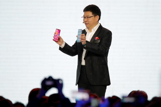 Cheered: Richard Yu, CEO of the Huawei Consumer Business Group, unveils the new Huawei P30 and P30 Pro smartphones during a well-received launch event in Paris, France. Photo: Reuters