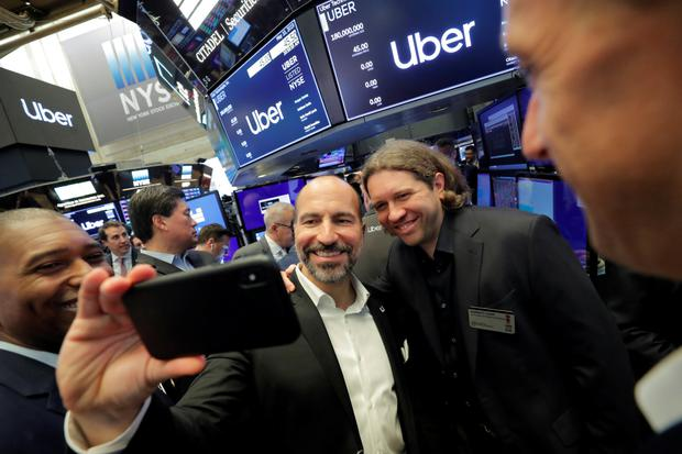 Uber ceo Dara Khosrowshahi and co-founder Garrett Camp are pictured taking a selfie on the NYSE floor.