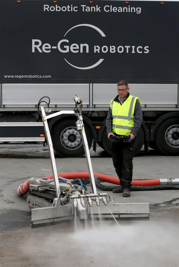 Sludge buster: James Power, the senior tanker and site supervisor at Re-Gen Robotics, operates one of the firm's tank cleaners