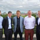 Firmwave CEO Adrian Burns and CFO Ciaran Burns, Taoglas co-chief executives Dermot O'Shea and Ronan Quinlan, and Firmwave director Fintan McGovern