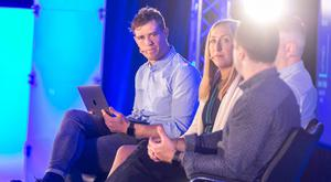 Moving on: Andrew Trimble chairing a panel at the One Zero 2019 sports business conference. Photo: Alan Rowlette