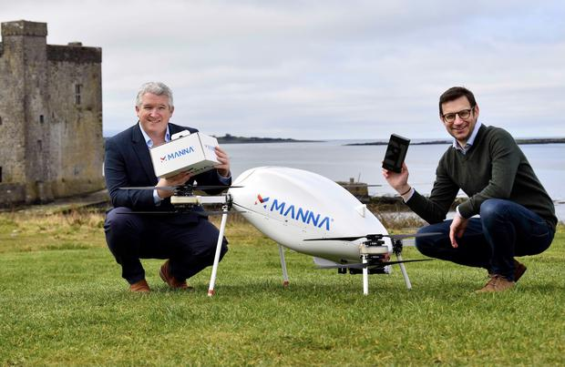Air drop: Eamonn Grant of Samsung and Manna Aero's Alan Hicks demonstrate drone deliveries of Galaxy devices in Oranmore, Co Galway