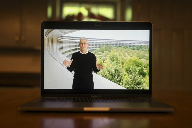 Apple CEO Tim Cook says 'it's still very important to physically be in touch with one another'. Photo: Daniel Acker/Bloomberg