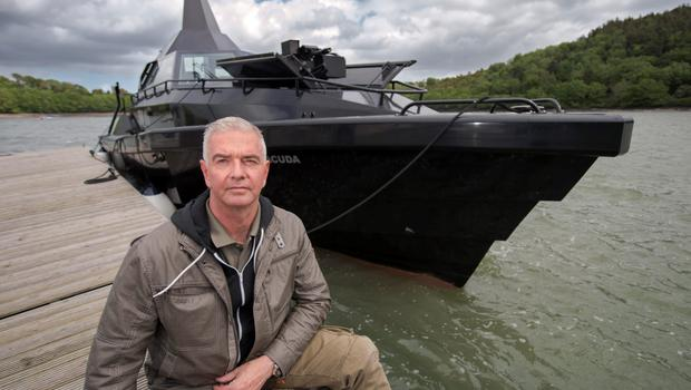 Frank Kowalski with 'Barracuda,' the military stealth vessel he has built, at East Ferry Marina, Cork