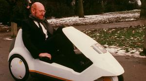 Sir Clive Sinclair in his electric vehicle, the Sinclair C5. Photograph: PA Media