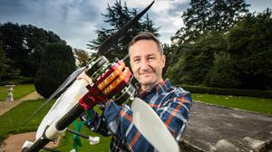 Entrepreneur Bobby Healy with one of the Manna drones. Picture by Mark Condren