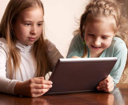 Children are now spending an average of 15 hours online every week. Picture posed