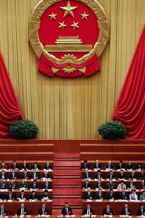 Chinese President Xi Jinping (centre), will deliver a speech to the Boao Forum for Asia today
