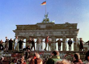 West Germans hold hands and dance in the sunshine of the morning of November 11