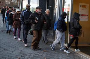A queue outside an unemployment office in central Madrid yesterday