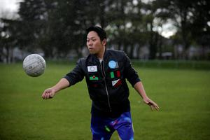 Bu Xue Liang takes part in a GAA match for a Chinese reality TV programme at Na Fianna GAA Club in Glasnevin, Dublin. Picture: Arthur Carron