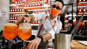 A bartender pours a drink at a Campari inauguration of a new brand house for Aperol in Venice. Photo: Manuel Silvestri/Reuters