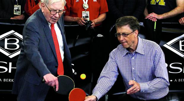 Berkshire chief Warren Buffett plays table tennis with Microsoft chairman Bill Gates in Omaha during the investment company's annual meeting at the weekend