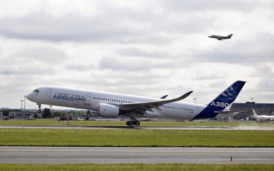 An Airbus SAS A350, produced by a unit of European Aeronautic, Defence & Space Co. (EADS), takes off on its first flight in Toulouse, France on Friday, June 14, 2013. Airbus SAS's new A350 wide-body lifted off for its maiden voyage at 10:00 a.m. before a crowd of 12,000, in a show of confidence that the jet can enter service in late 2014 and challenge Boeing Co. Photographer: Balint Porneczi/Bloomberg