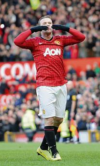 Manchester United's Wayne Rooney celebrates scoring another goal wearing Nike boots.