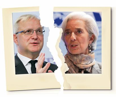 EU Economy Commissioner Olli Rehn (far left) and IMF chief Christine Lagarde are at odds over bailout policies