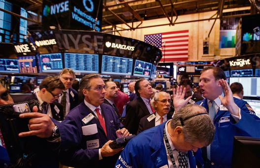 Traders on the floor at the New York Stock Exchange