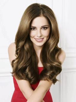 Brunette Cheryl Cole possibly enjoys Match of the Day and is a fan of Corrie