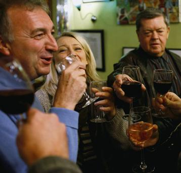 Wine-lovers taste the famous Beaujolais Nouveau during the official launch of the 2013 vintage in Lille, France yesterday.
