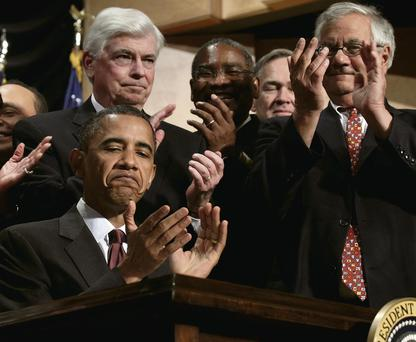 U.S. President Barack Obama applauds after signing the Dodd-Frank Wall Street Reform and Consumer Protection Act during a ceremony at the Ronald Reagan Building and International Trade Center in Washington, D.C.