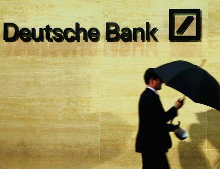 Shares at Germany's biggest bank fell following the surprise fourth-quarter loss