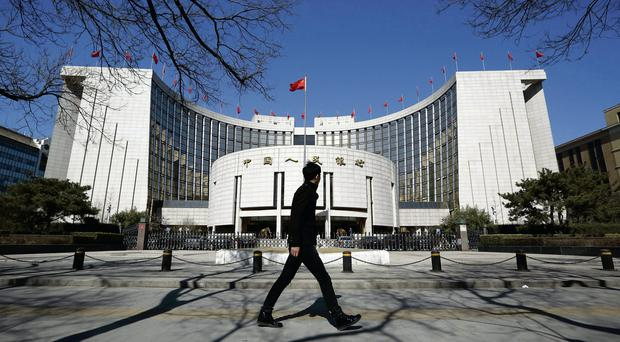 A man walks past the People's Bank of China HQ in Beijing Picture:Tomohiro Ohsumi