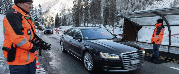 Swiss police check vehicles on the first day of the World Economic Forum