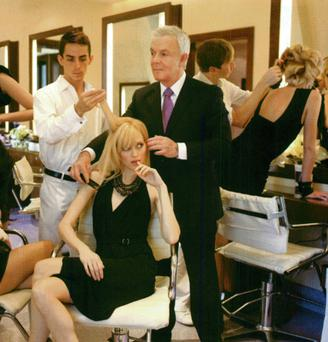 STYLIST TO THE STARS: John Barrett oversees operations at his NY salon