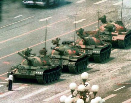 A man stands in front of a line of tanks in Tiananmen Square on June 5, 1989 Credit: Jeff Widener