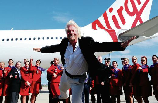 Sir Richard Branson poses alongside staff members