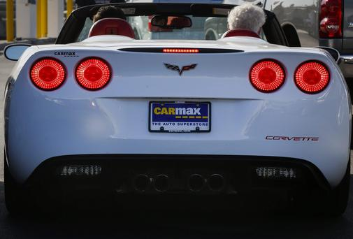 A customer prepares to test drive a used General Motors Chevrolet Corvette