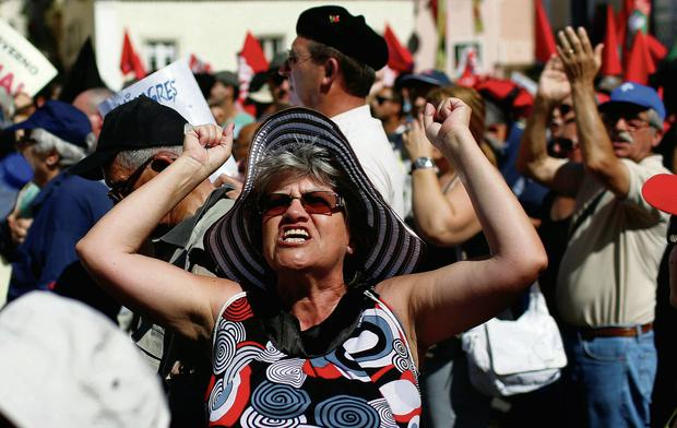 A demonstrator at a union-led protest in Lisbon yesterday. Photo: Rafael Marchante