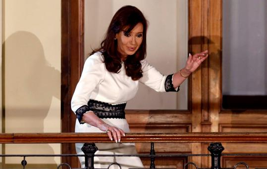 Argentina's President Cristina Fernandez de Kirchner (C) speaks to supporters from a balcony inside the Casa Rosada Presidential Palace in Buenos Aires. Photo: Reuters/Marcus Brindicci
