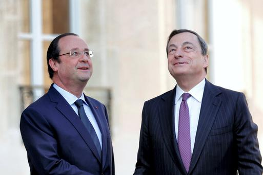 French President Francois Hollande welcomes European Central Bank President Mario Draghi at the Elysee Palace in Paris