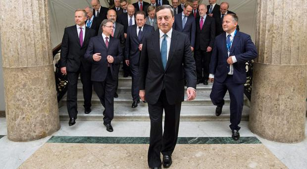 President of European Central Bank Mario Draghi walks in front of the ECB governing council prior to their meeting in Naples, Italy