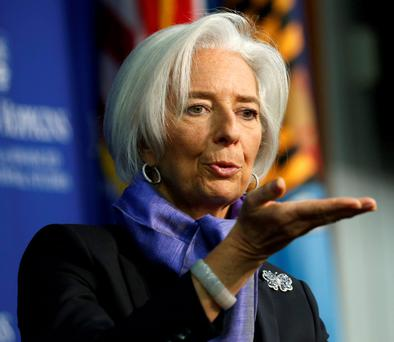 THE BOSS: International Monetary Fund managing director Christine Lagarde gestures as she speaks about the global economy. Photo: Kevin Lamarque/Reuters