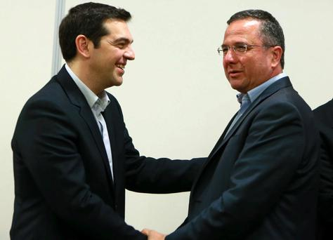 Greece's new Prime Minister Alexis Tsipras (L) meeting with the President of Cyprus Green Party, Giorgos Perdikis on February 2, 2015 in the capital Nicosia.