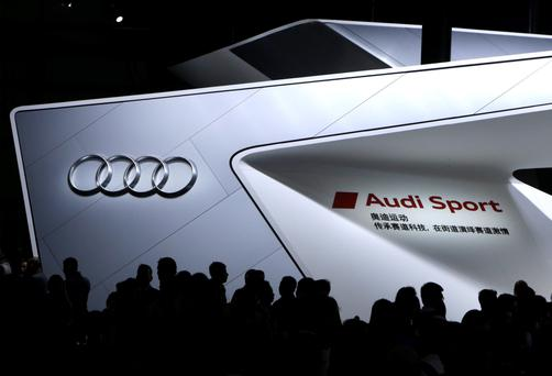 Visitors throng Audi's exhibition booth at Auto China 2014 in Beijing