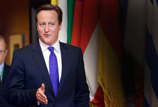 Britain's David Cameron leaves an EU leaders summit in Brussels during his first term as prime minister