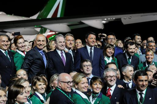 Silvano Cassano, CEO of Alitalia; James Hogan, President and CEO of Etihad Airways; Luca Cordero di Montezemolo, Chairman of Alitalia; and Matteo Renzi, Italian Prime Minister, with Alitalia staff at the event outside Rome
