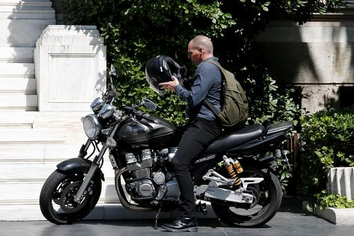 Greek Finance Minister Yanis Varoufakis leaving Prime Minister Alexi Tsipras's office in Athens