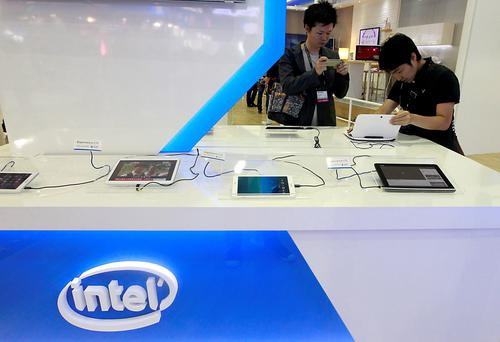 Visitors look at tablets during the Computex exhibition in Taipei last year - Taiwan is a massive exporter of computer technology