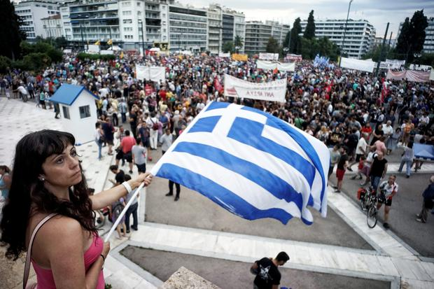 Protesters attend an anti-austerity pro-government rally in front of the parliament building in Athens.