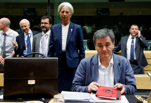 Greek Finance Minister Euclid Tsakalotos and IMF managing director Christine Lagarde (back centre) at the eurozone finance ministers meeting in Brussels yesterday