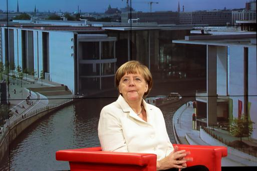 German Chancellor Angela Merkel waits prior to an interview at a TV studio in Berlin