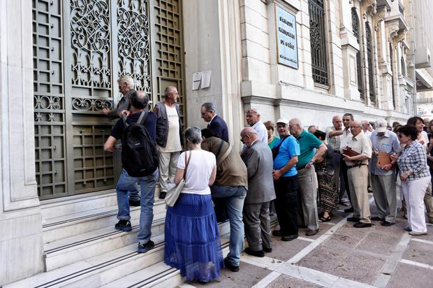 Queues outside an Athens bank yesterday