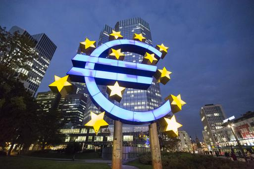 The euro sculpture in front of the European Central Bank headquarters in Frankfurt, Germany