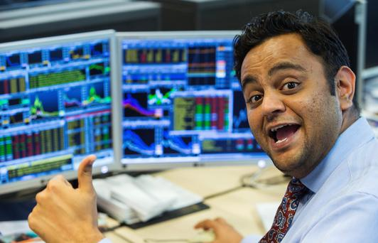 Relief on the face of a trader at KBC bank at its headquarters in Brussels as European and American markets rallied after the misery of Black Monday. The joy was short-lived, however, as US stocks dropped gains made earlier in the day.