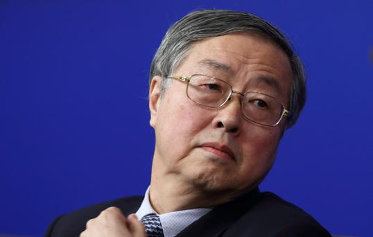 Zhou Xiaochuan, governor of the People's Bank of China (PBOC), attends a news conference in Beijing, China, on Thursday, March 12, 2015. China's central bank is pushing ahead with plans to liberalize interest rates even as the economy slows, a reform that would effectively end a dual-track rate system that has seen savers subsidize decades of investment-fueled growth. Photographer: Tomohiro Ohsumi/Bloomberg