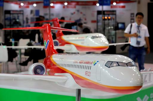 Models of the ARJ21 regional jet from Commercial Aircraft Corp of China (COMAC) are displayed at the Aviation Expo China 2015 in Beijing, China